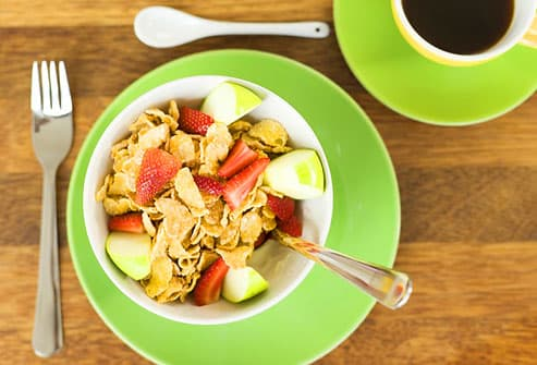 Breakfast with cereals and fruit and coffee