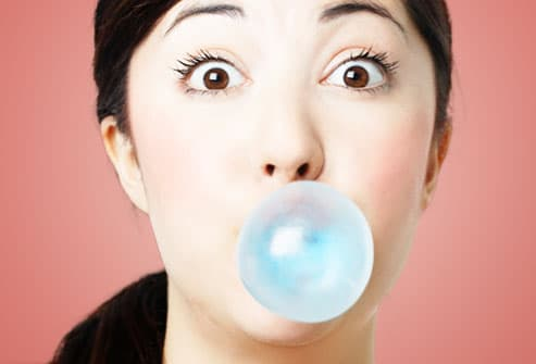 Woman With Gum Blowing Bubble