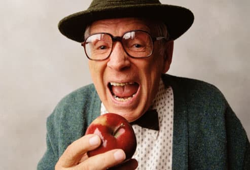 Old Man about to Bite into Apple