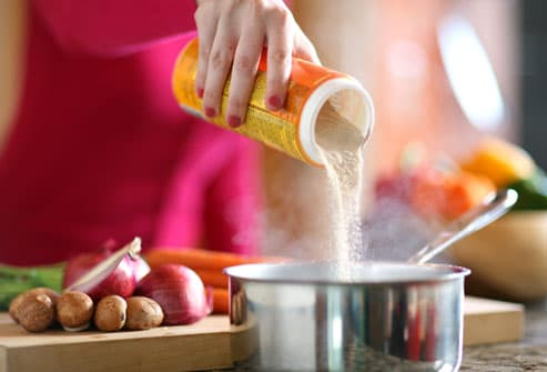 Woman Cooking With Fiber Supplement