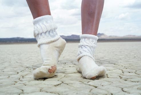 girl in socks standing in desert