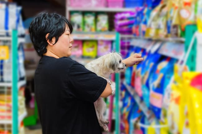 woman choosing dog food