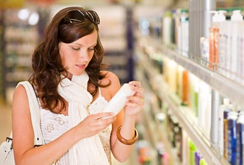woman looking at shampoo