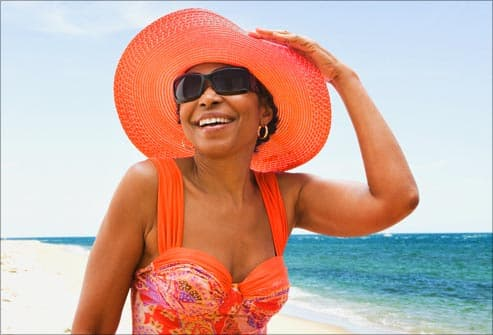 smiling woman wearing sun hat