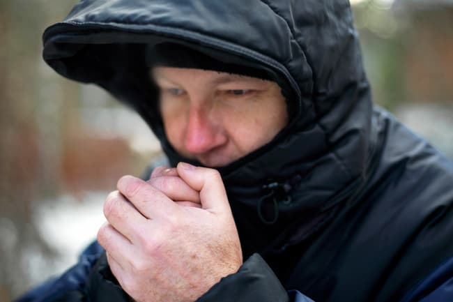 photo of man bundled up in winter