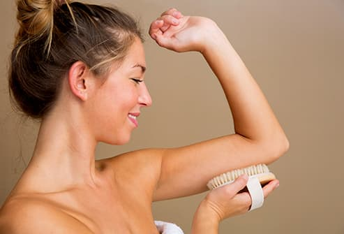 woman using body brush