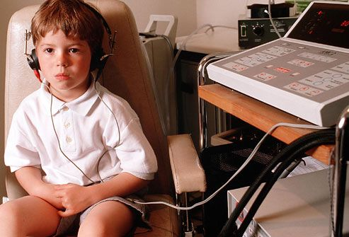 young boy receiving a hearing test