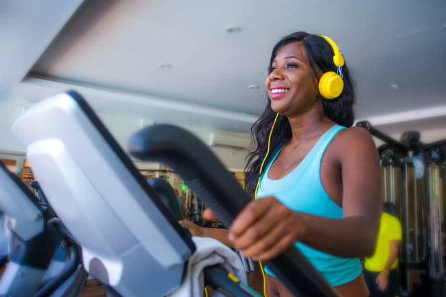 photo of woman using elliptical