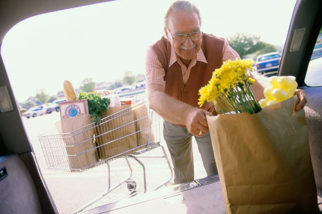 photo of man packing groceries
