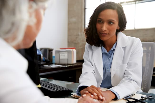 photo of doctor talking with patient