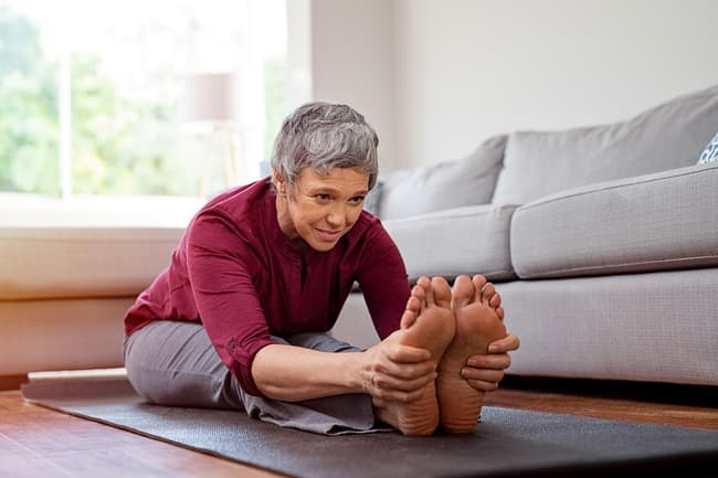 photo of mature woman stretching