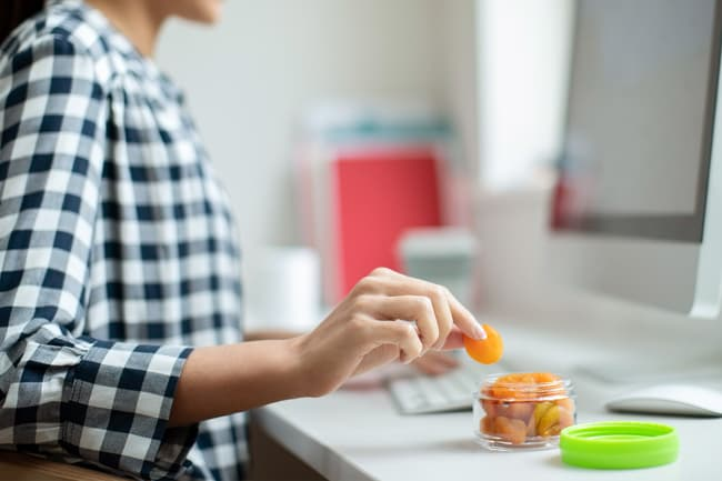 photo of woman snacking