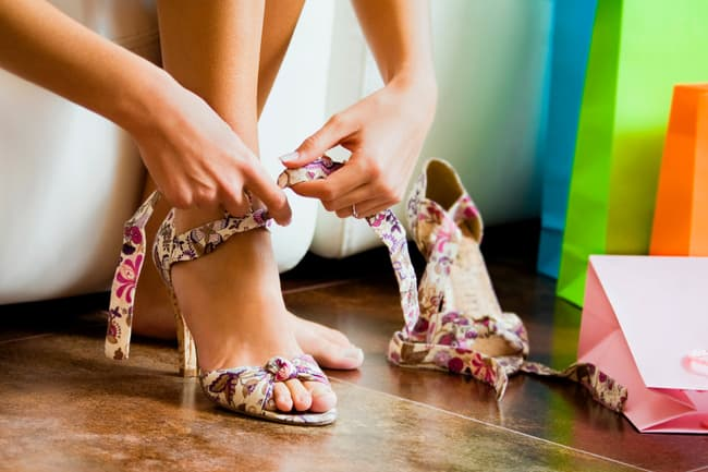 photo of woman trying on shoes close up