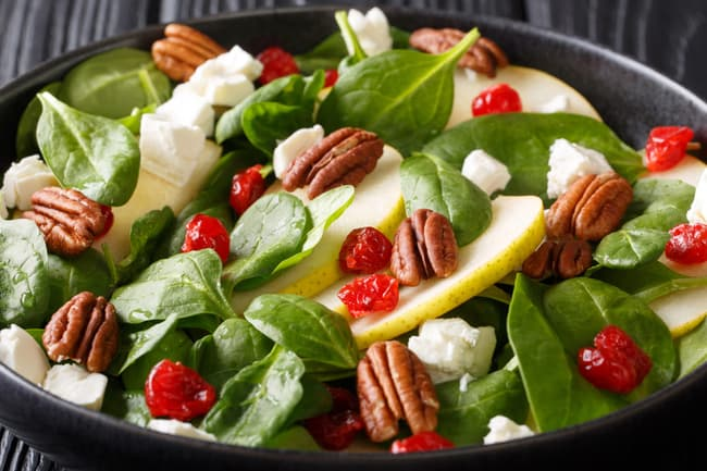photo of healthy salad with walnuts and fruit