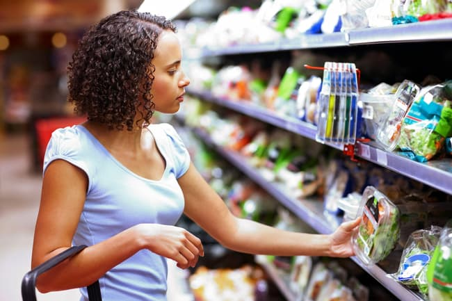 photo of woman shopping in supermarket