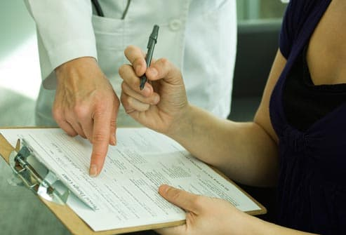 patient completing medical paperwork