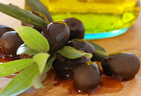 Olives in oil on tabletop