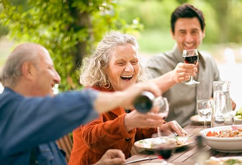 italian family drinking red wine with meal