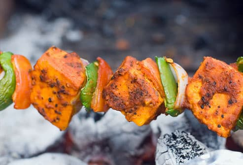 Close-up of a Paneer Tikka being prepared