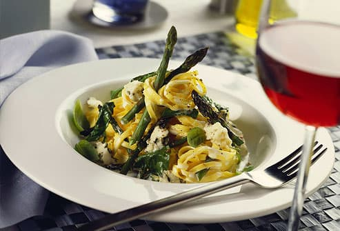 Ribbon pasta on green asparagus& gorgonzola