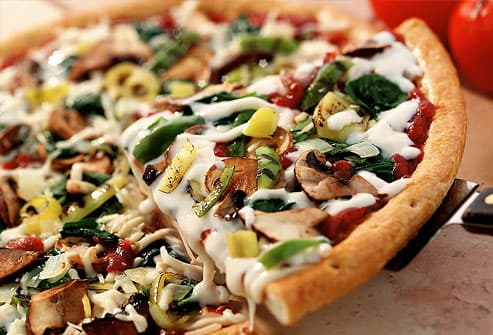 Thin crust pizza topped with fresh vegetables