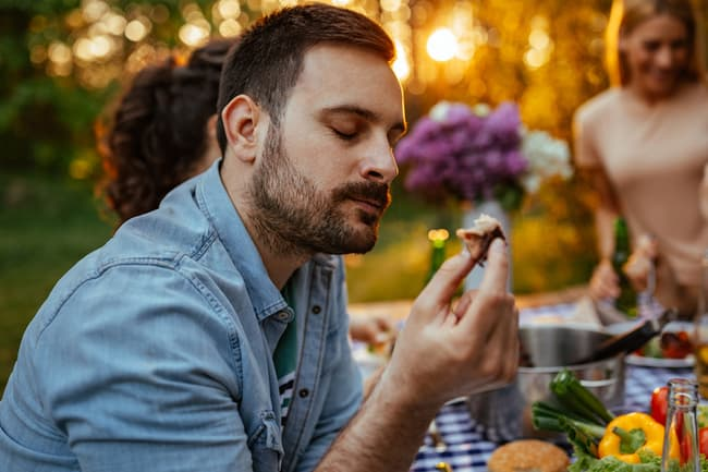 photo of man savoring food