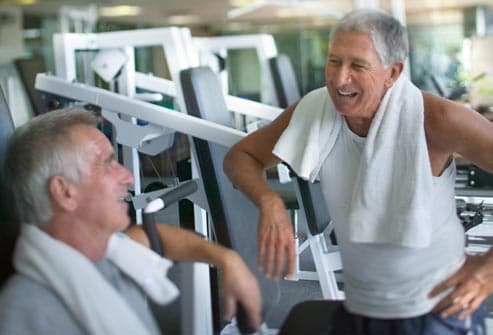 older men talking at gym