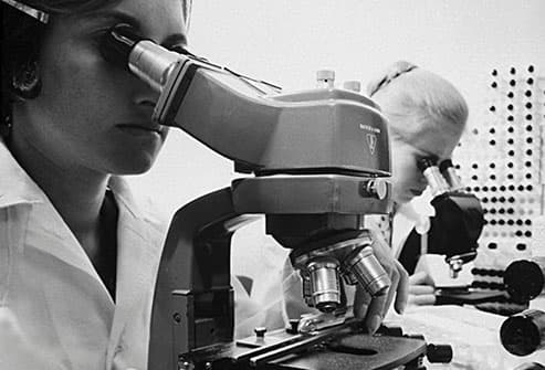 scientists in lab circa 1964