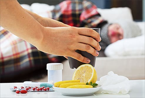 woman offering up cold remedies