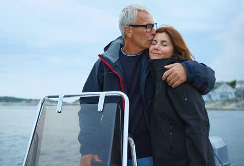 Man Embracing Woman on Boat
