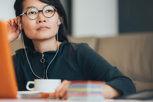 photo of woman talking on headset