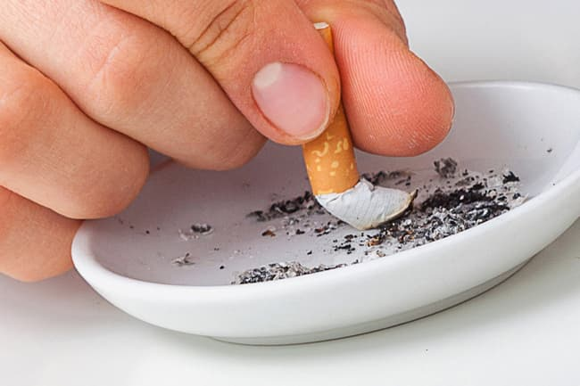 putting out cigarette in ashtray