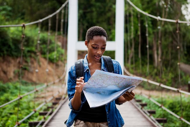 photo of woman looking at map