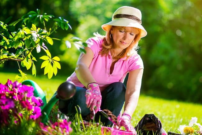 photo of woman gardening