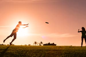 photo of couple playing frisbee