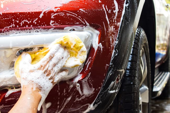 photo of hand washing car
