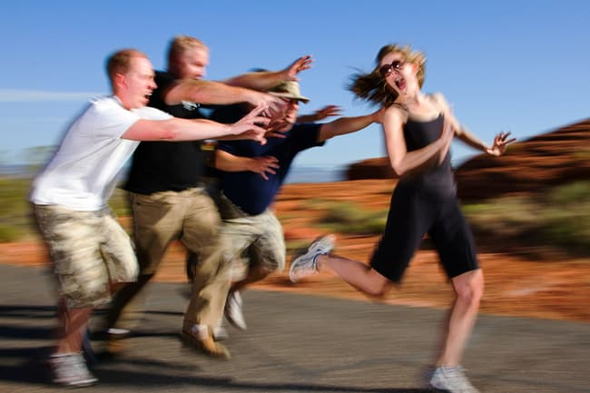 photo of woman running from people on jog