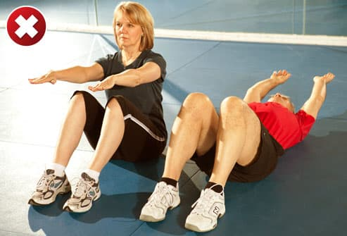 Two People Doing Sit Ups