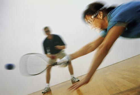 woman playing raquetball
