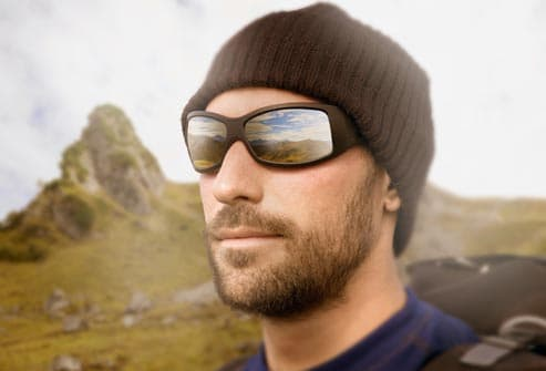 hiker wearing reflective sunglasses
