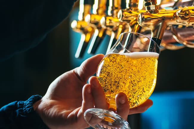 photo of pouring beer from tap