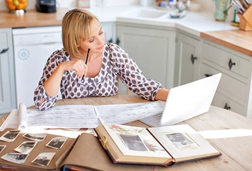 woman at table with family tree