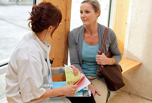 woman and doctor discussing paperwork