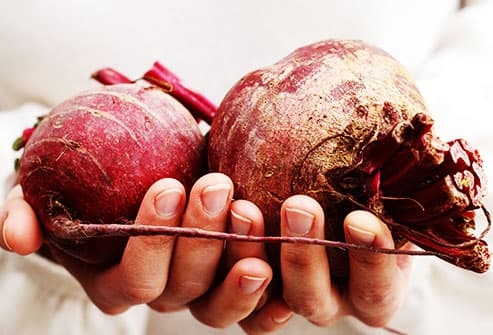 person holding beets