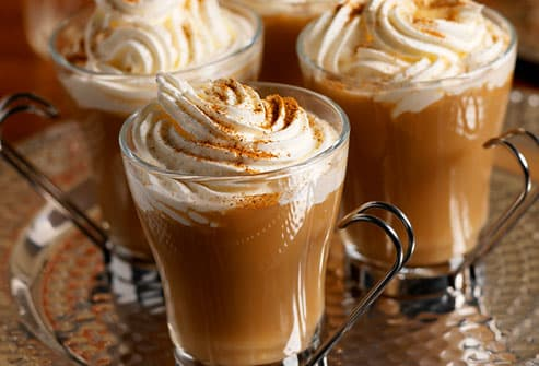 Pumpkin coffee with whipped cream and nutmeg