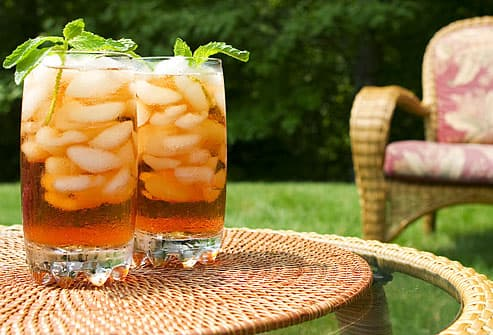 Iced tea garnished with mint leaves