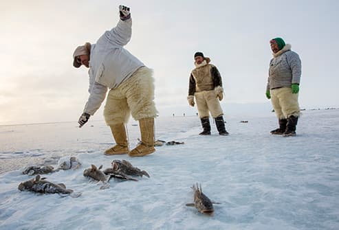 Inuit people fishing