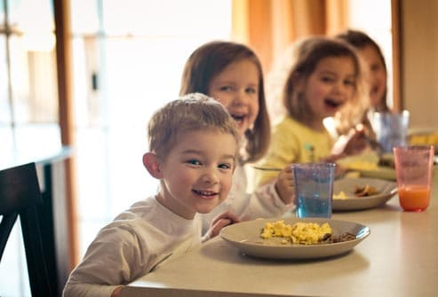 children at table eating breakfast