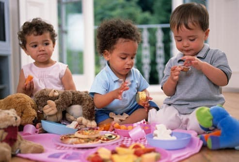 children having indoor picnic