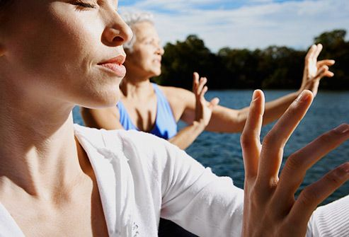 women doing tai chi by water